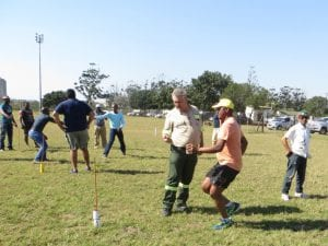 Men team building in field