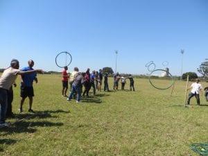 People throwing hoops in a field