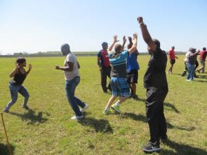 People cheering in a field