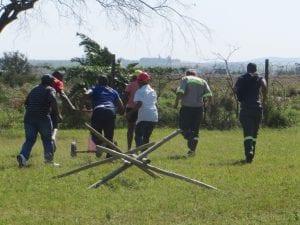 Men building wooden structure
