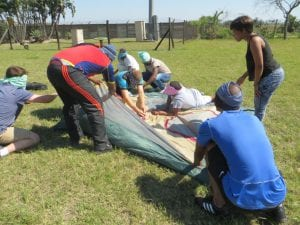 People building tent in field