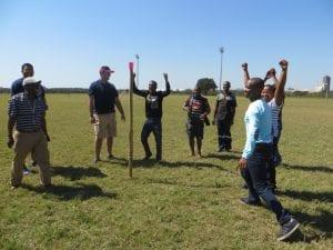 Men team building in a field