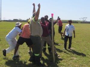 Men cheering in field