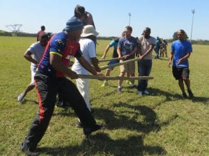 People team building with poles