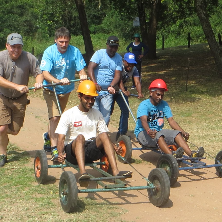 Men pushing carts