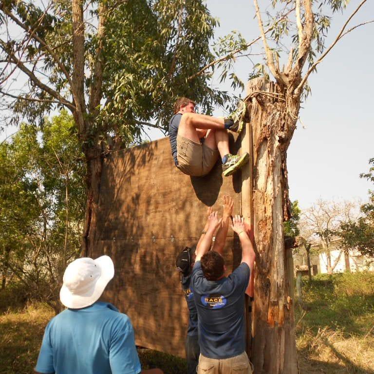 Man climbing wooden structure