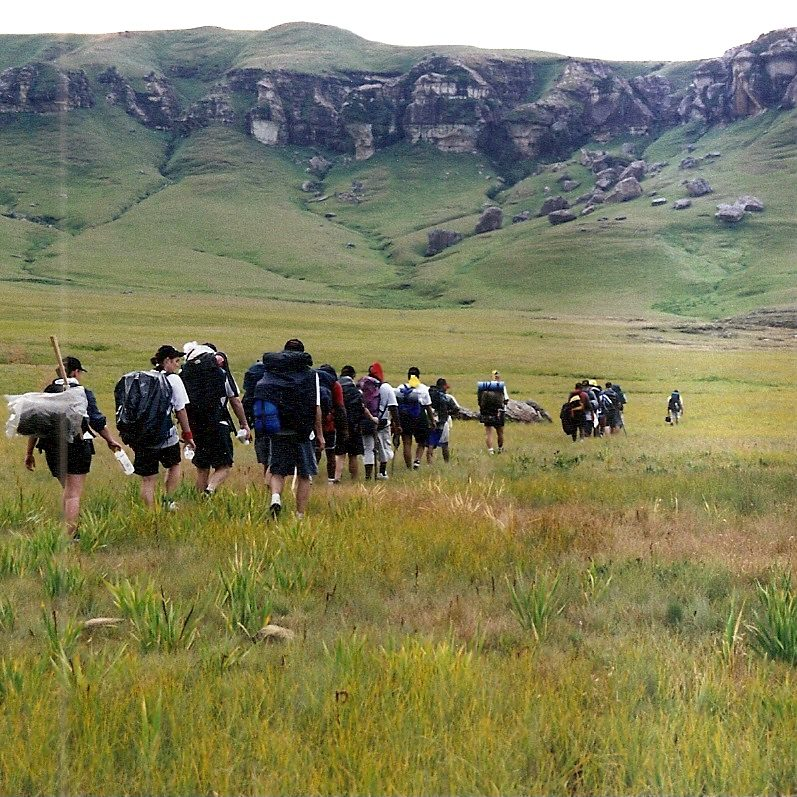 People hiking in field
