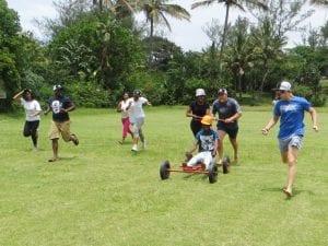 People pushing cart and running
