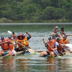 Corporate Entertainment Ideas – people rafting across river
