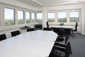 Empty Chairs and Desks in Office Space