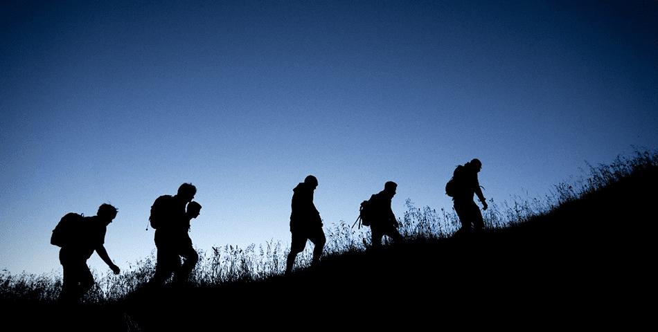 People walking silhouette in scotts teambuilding