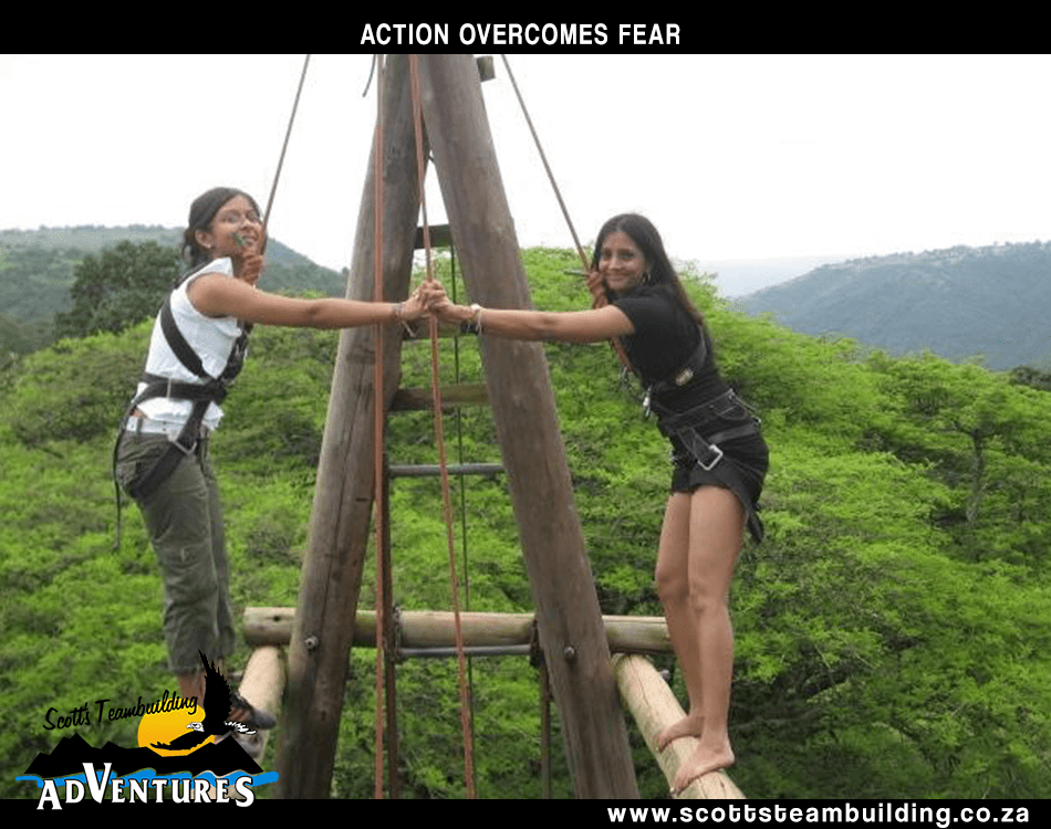 two girls on an obstacle course