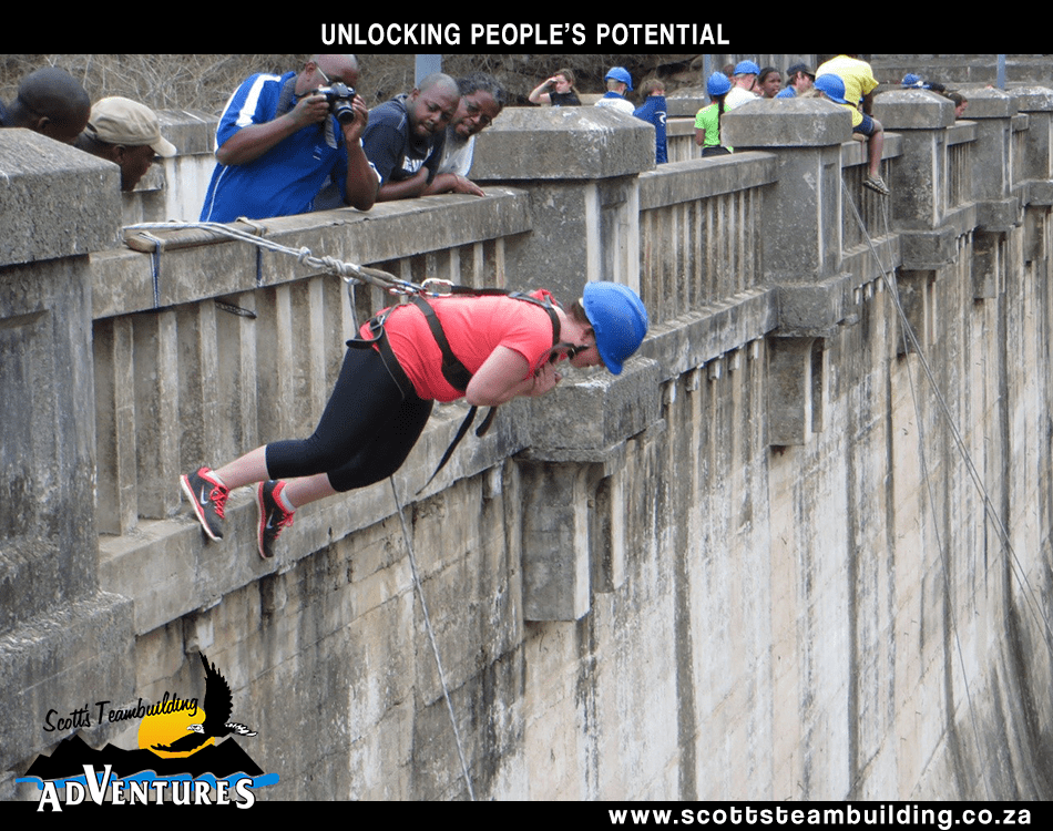 a women abseiling down a wall
