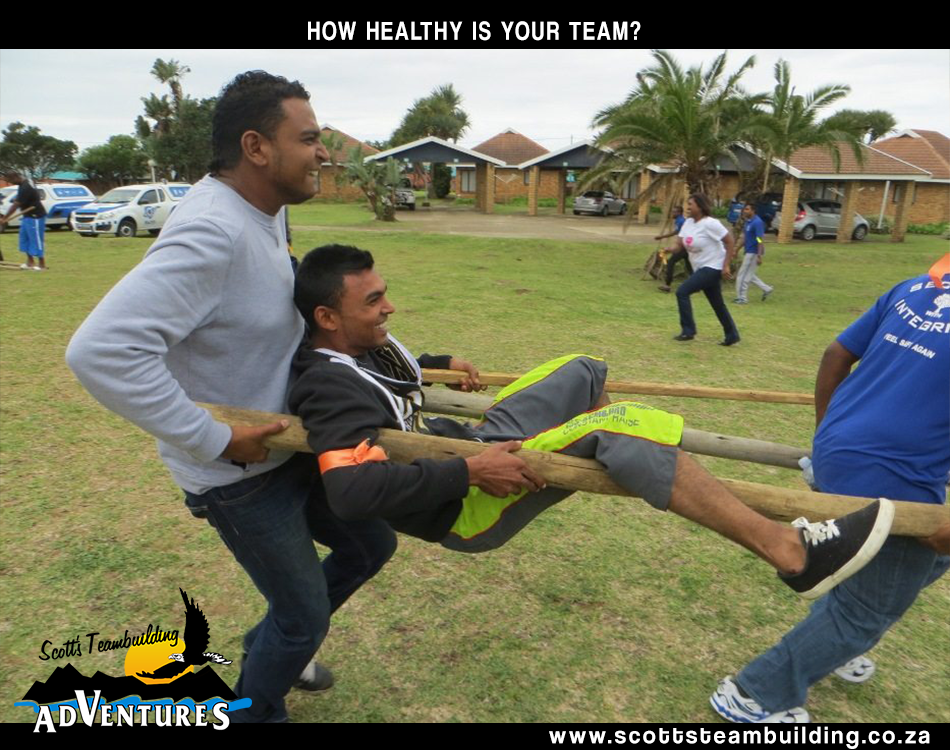 Team carrying a person with two poles